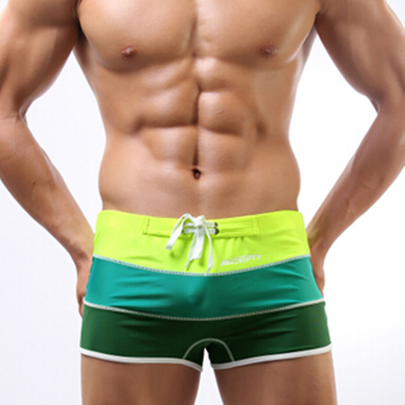 2015 new Men Swimwear Sexy swimming trunks Low waist Stripe Pocket beach spa pool Shorts Boxers Sports suit Men soft Swimsuit(China (Mainland))