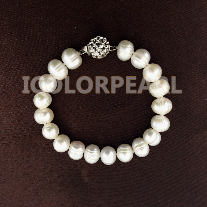 Cheapest Price For 9-10mm Potaotoround White Freshwater Pearl Bracelet On Elastic Or With A Flower Clasp(China (Mainland))