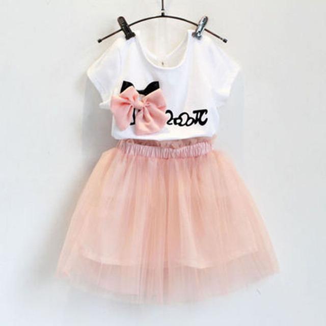 2016 летний новый девушки сладкий с бантом с коротким рукавом + помпоном юбка костюм