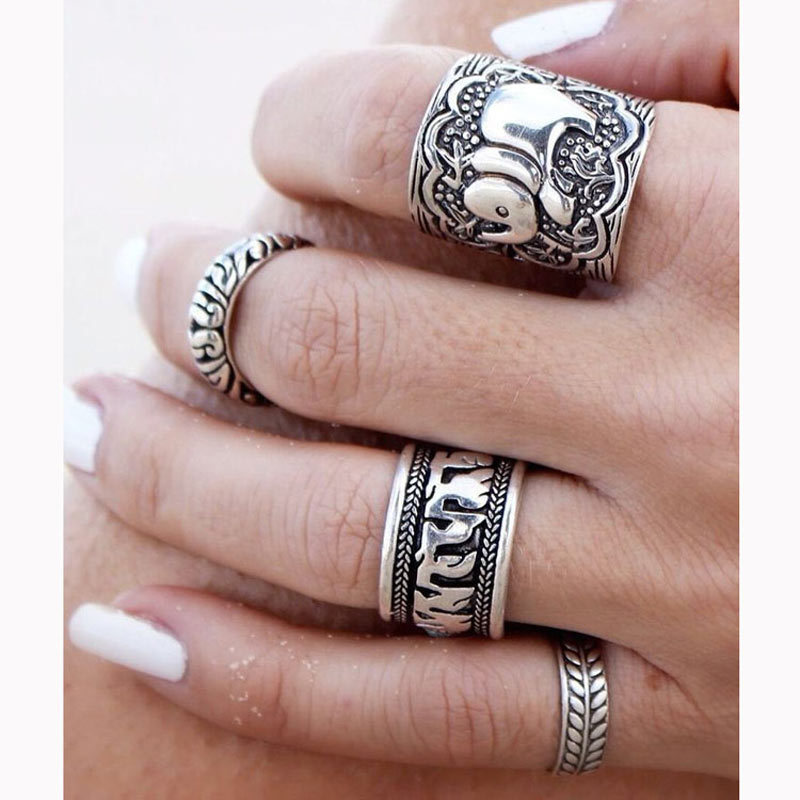 4pcs/Set Vintage Punk Ring Set Unique Carved Antique Silver Elephant Totem Leaf Lucky Rings for Women Boho Beach Jewelry(China (Mainland))