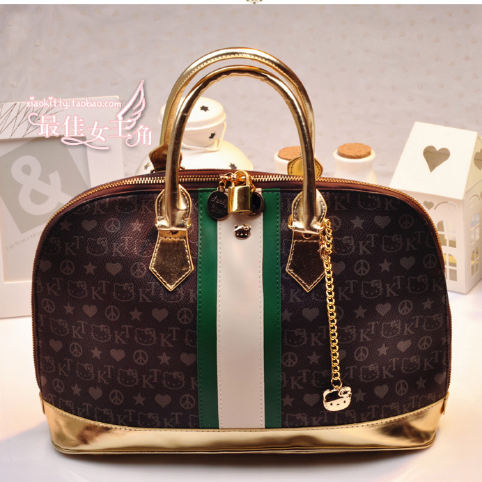 Free Shipping 2015 Sanrio Fashion Hello Kitty Shell Bag with Lock Women's Handbag Band Bag Women Leather Bags(China (Mainland))