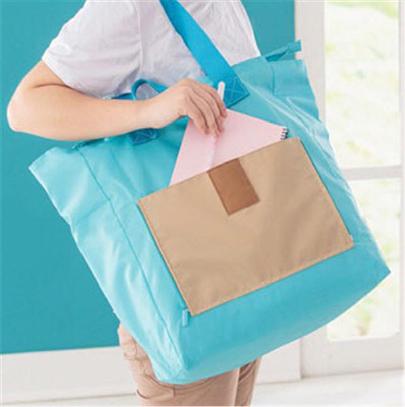 Korean style Collision Color Design Outdoor Travel Portable Handbag Folding Storage Bags Four Color Choose(China (Mainland))