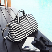 2016 Women Travel Bags Large Capacity Folding Luggage Travel Handbags Duffle Bag Pu Leather Waterproof Stripe Shoulder Bags(China (Mainland))