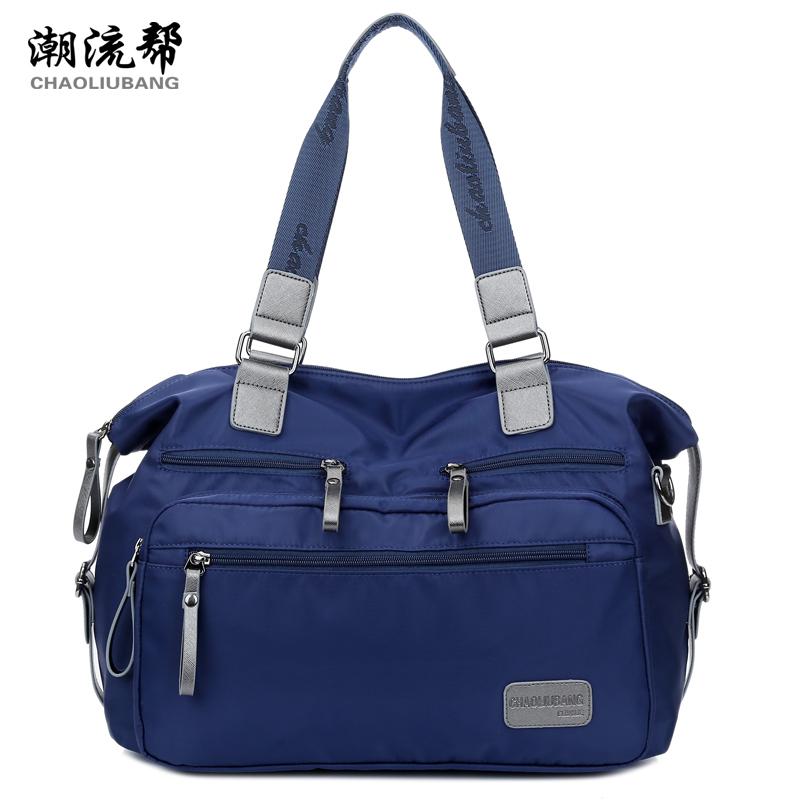 Cloth big solid color nylon waterproof handbag 2015 women's handbag brief travel bag casual preppy style school bag(China (Mainland))