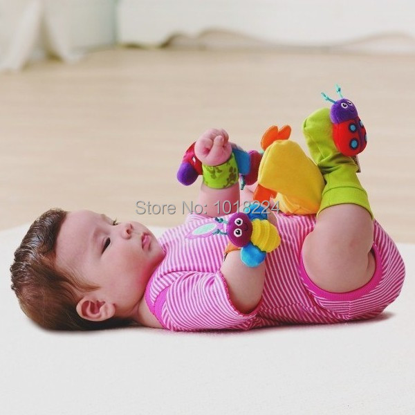 2015 fashion new Baby rattle toys 4 pcs/lot Garden Bug Wrist Rattles & Foot Socks Toy Christmas music mobile toy for baby kids(China (Mainland))