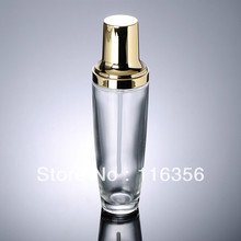 120ml transparent glass lotion bottle with gold pump for Cosmetic Packaging