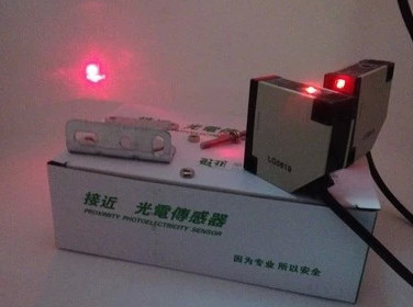 FREE SHIPPING E3JK-R30N1 Laser on the photoelectric switch sensor DC DC5~30V(China (Mainland))
