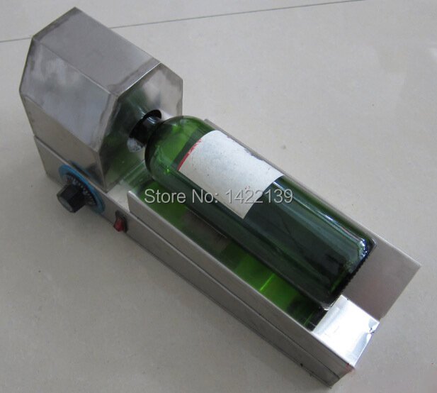 PVC heat shrinkable plastic bottle cap red wine shrink machine(China (Mainland))
