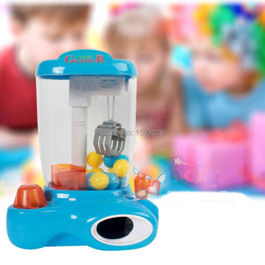 Batteries operated Mini clip candy machine crane machine candy grabber electric egg grabber with 12 plastic egg children toy(China (Mainland))