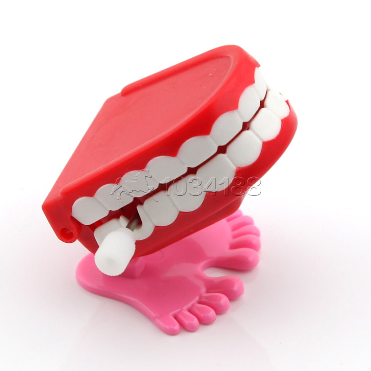 12 PCS Plastic Toys Jump Teeth with Chain for Children(China (Mainland))
