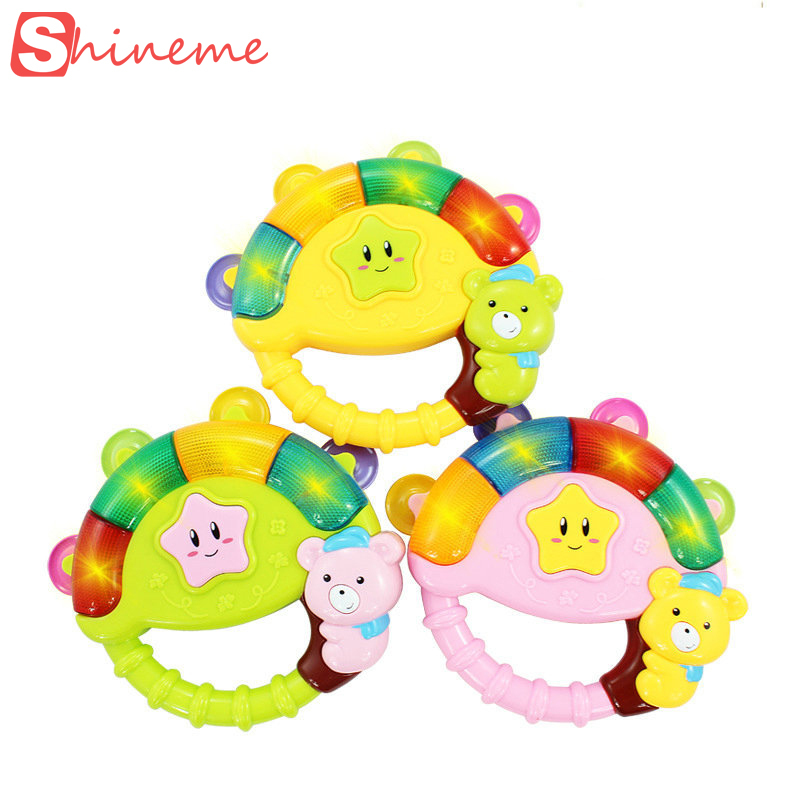 2015 new Baby boy girl Rattle s Musical Flashing toy Hand ring Bell children infant kids educational toys tell chinese story(China (Mainland))