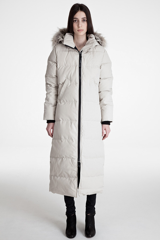 Women's long down coats deliver more coverage against harsh winter weather while offering a sophisticated, professional look. A belted or drawstring waist provides a flattering, feminine silhouette. Wear women's shearling coats, such as those by Maximilian Furs, for a natural style.