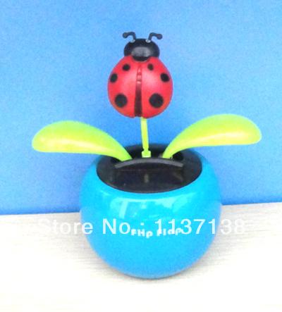Wholesale 10Pcs Per Lot Magic Cute Lady Bug Novelty Car Decoration Flip Flap Solar Powered Dancing Flower(China (Mainland))