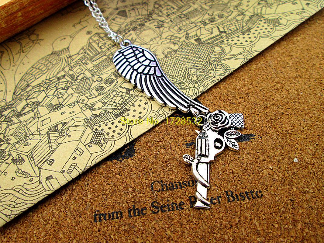 12pcs/lot fashion 48*15mm antique silver Angel wing Charm big wing with 31*9mm Guns and Roses pendant necklace(China (Mainland))