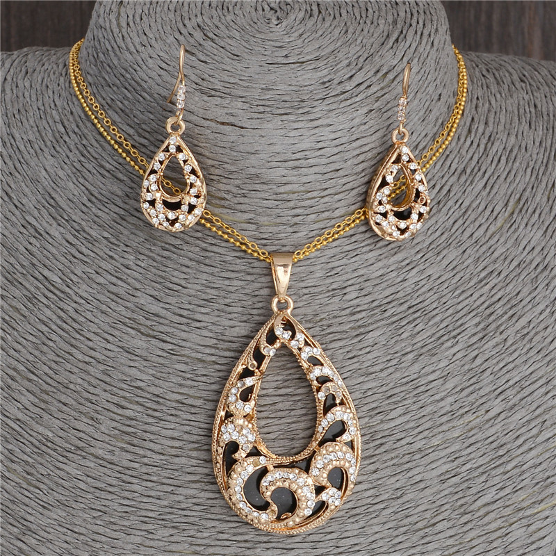 Buy new design dubai gold jewelry set hollow out water drop pendants necklace Design and style fashion jewelry