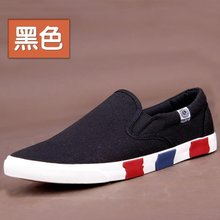 The new summer men s canvas shoes low white all black a pedal lazy shoes British