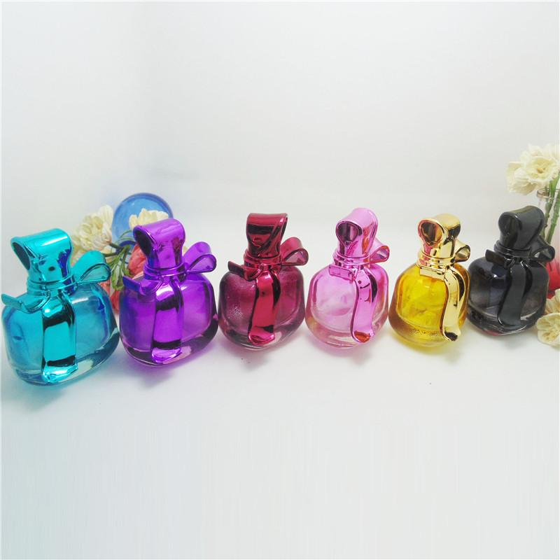 Free shipping 1pcs/lot 15ml UV Bow Cover Perfume Bottles Glass Empty Bottles Mini Ztomizer Bottles Brand Name Perfume Bottles(China (Mainland))