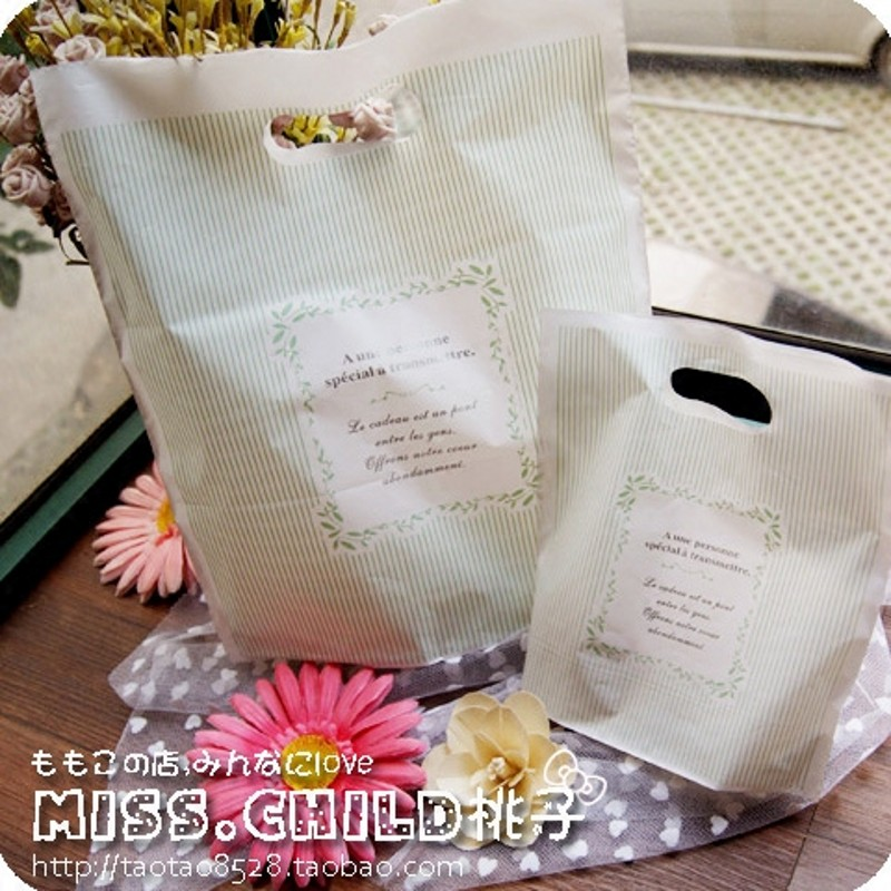 50PCS Vertical stripes dig pocket HDPE Packaging bags Gift and decorations Hand Length Handle plastic Packing bag B005(China (Mainland))