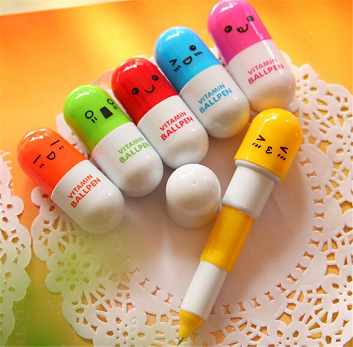 6ps /lot Lovely Smiling Face Pill Ballpoint Pen Plastic Telescopic Vitamin Capsule Ballpen For Kids Gift School Use(China (Mainland))