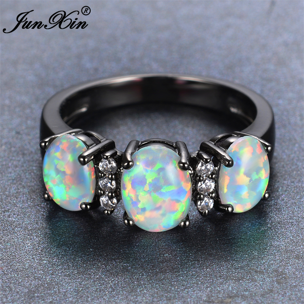 JUNXIN 2017 New Fashion White Fire Opal Engagement Ring Vintage Black Gold Wedding Rings For Men And Women New Year Gifts(China (Mainland))