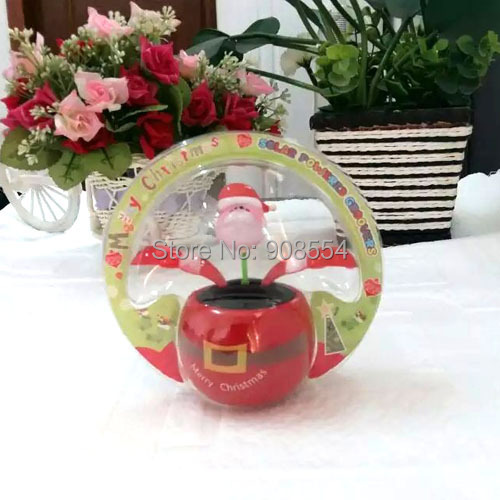 Wholesale Free Shipping 10Pcs Per Lot No Battery No water New Style Santa Claus Flip Flap Happy Dancing Solar Flowers(China (Mainland))