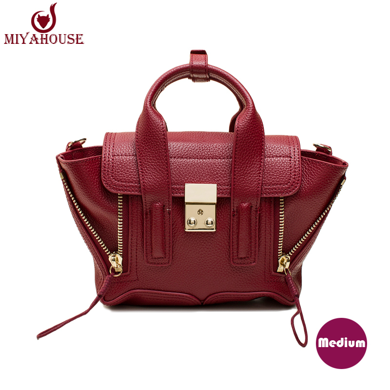 Design  Handbags Messenger Bag Smiley Little Monster Double Zipper Trapeze Bags Genuine Leather Handbags cute shoulder bag
