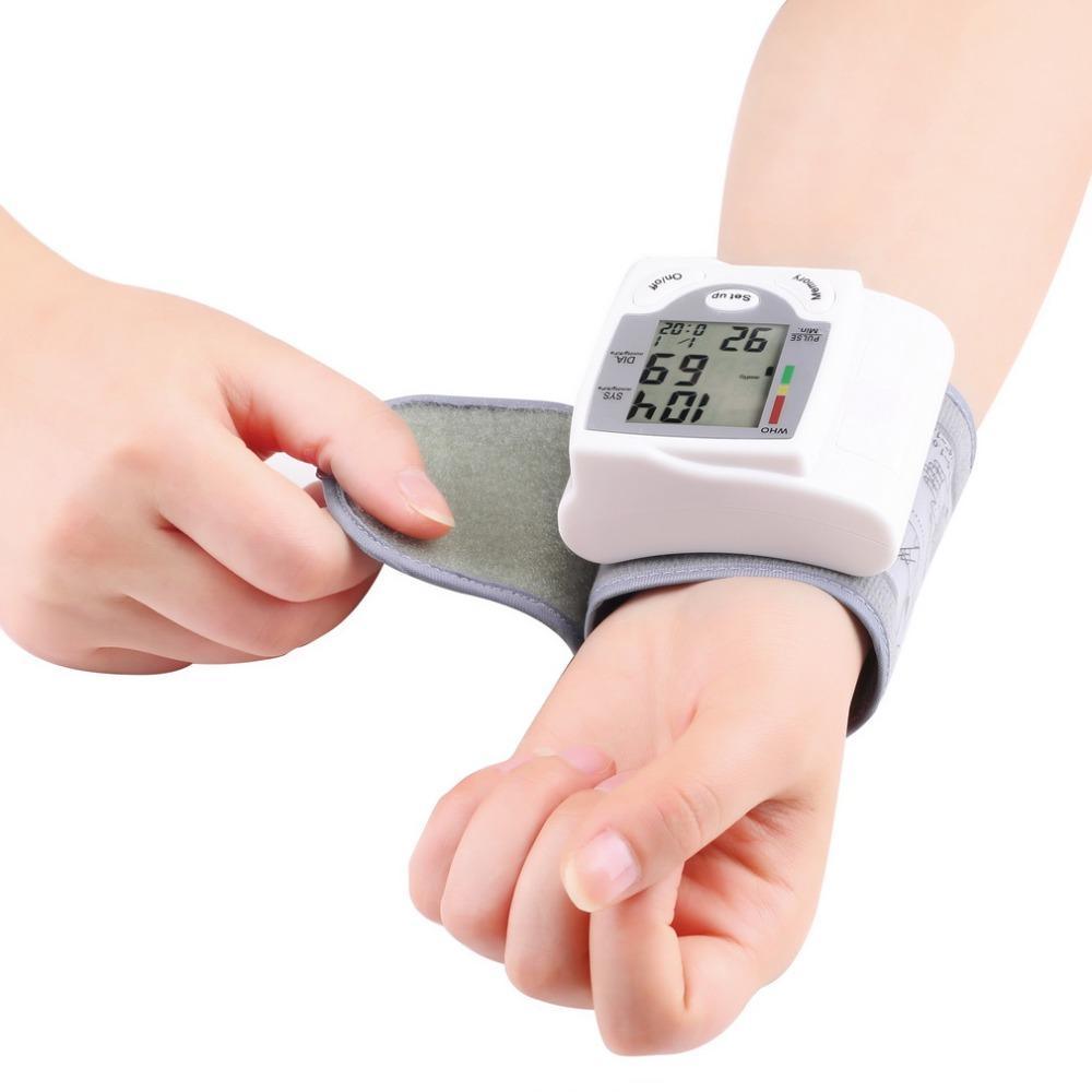 Automatic Digital Wrist Cuff Blood Pressure Monitor Arm Meter Pulse Sphygmomanometer Heart Beat Meter LCD Display 2015 New Quali(China (Mainland))