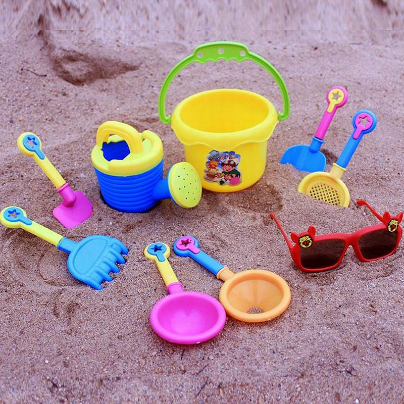 9pcs Funny Sand Excavating Toys Seaside Sand Beach Play Water Tools Kids Toy Set With Sunglasses Spade Shovel Hourglass Paddle(China (Mainland))