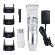 T084 kemei hair clipper 110V-220V + Extra Battery professional electric shaving machine barber hair trimmer cutting beard(China (Mainland))