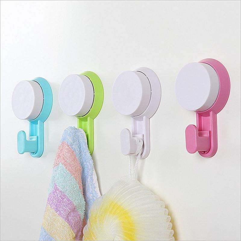 Strong Suction Hooks plastic wall hooks Wall load - bearing hook no trace Hanger Kitchen Bathroom Free shipping(China (Mainland))