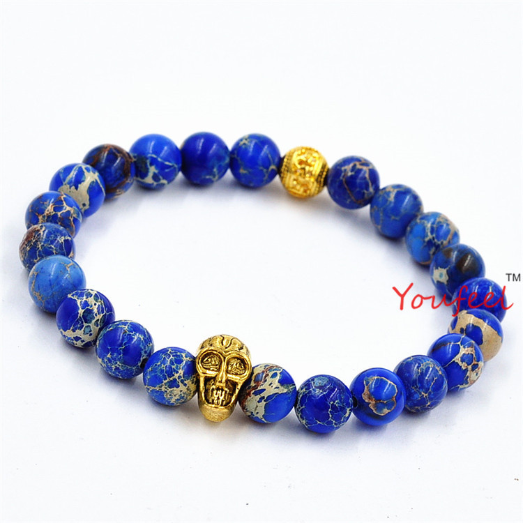 Wholesale 2015 New Design High Grade Jewelry 8mm Blue Sea Sediment Stone Bead with Bronze Gold and Silver Skull Bracelet<br><br>Aliexpress