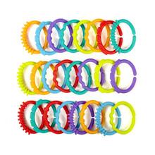 Trasporto libero del bambino giocattoli 0-12 mesi arcobaleno qq kids molari anello teether teddy catena frizione anello grembiule nuovo anno regali(China (Mainland))