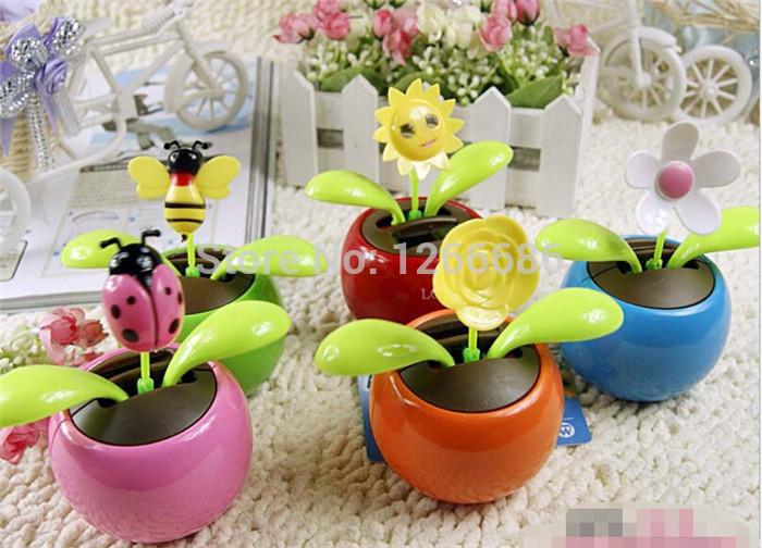 500pcs/lot Novelty Toys Flip Flap Solar Powered Flower for Car Flowerpot Swing Solar Flower(China (Mainland))