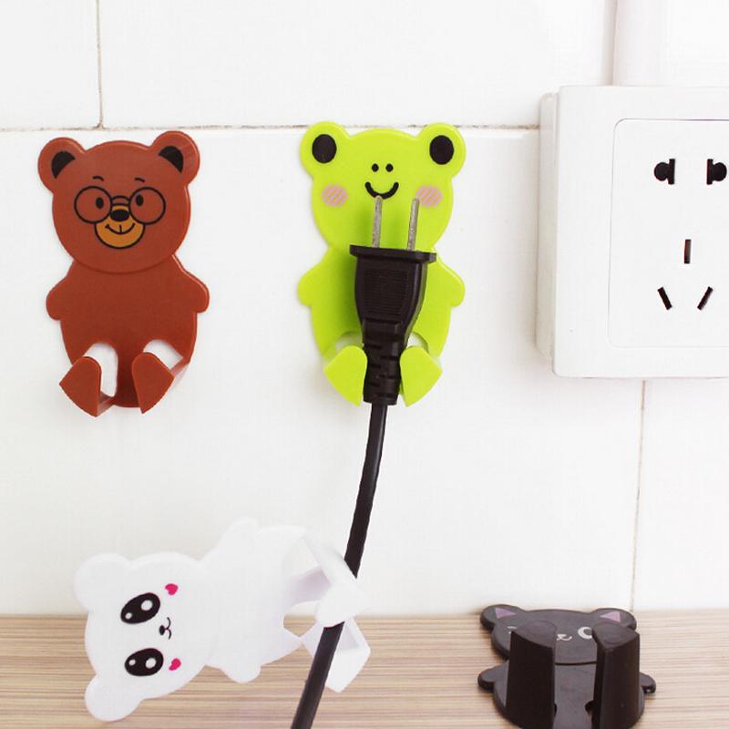 Cartoon 3M stick on wall shelf hook electrical plugs mounted socket storage rack plug sorting prateleira key holder wall(China (Mainland))