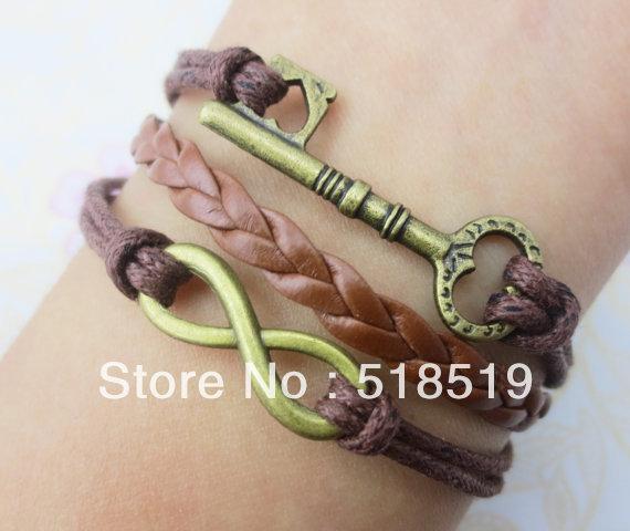 Free Shipping!6pcs/lot!Braided Brown Leather Ribbon Infinity Key Charm Bracelet Fashion Men Costume Alloy Perfume Jewelry O-661(China (Mainland))