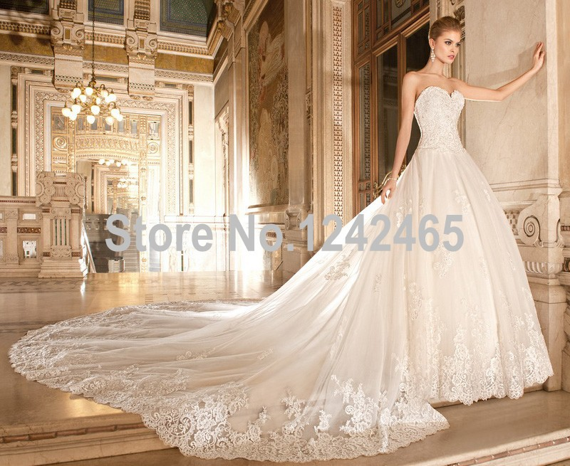 New arrival high grade wedding dresses exquisite appliques for Wedding dresses with royal length train