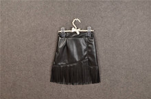Hu sunshine wholesale New 2016 spring babys faux-leather solid black tassel skirt (China (Mainland))