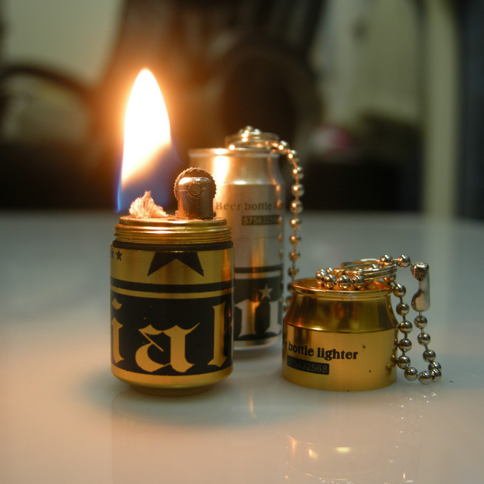 Creative Micro wheel pendant ultra-small oil lighter kerosene cans lighter wine monument(China (Mainland))