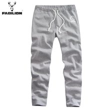 112403301 free shipping FABILION 2015 spring Casual outdoor joggers sport men pants with Printed letters, male cotton trousers