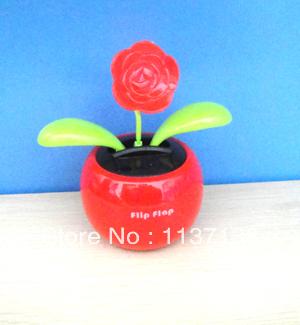 Wholesale 15 Pcs Per Lot Magic Cute Rose Top Novelty Flip Flap Solar Dancing Flowers(China (Mainland))