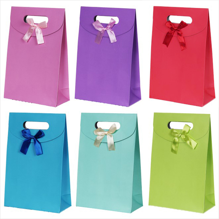 12pcs/lot free shipping fashion wedding accessories gift paper bag for jewelry pure candy color bowknot bags(China (Mainland))