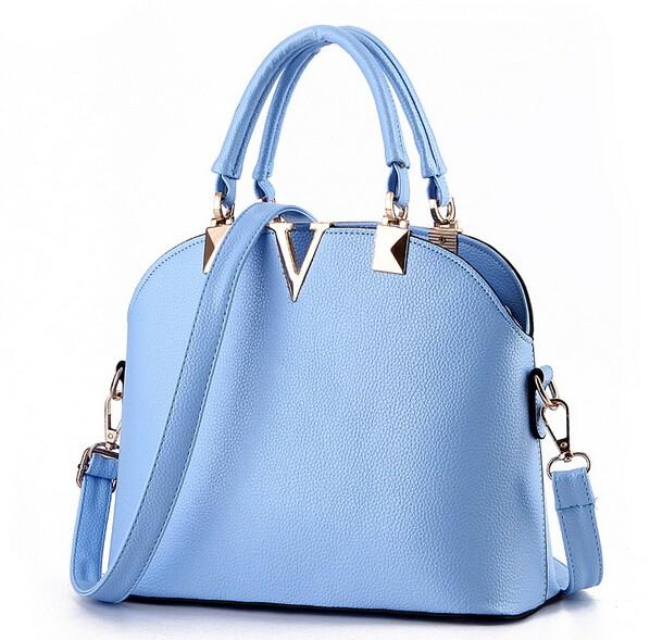 Женская средняя сумка на коротких ручках и длинном ремне синяя. фото