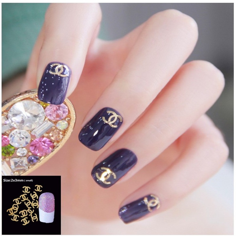 100Pcs/Pack 3D Nail Art Decorations 18 Model Plated Sheet Nails For Glitter Charms DIY Nail Tools Logo Pentagram Snowflake Pine(China (Mainland))