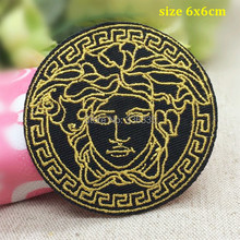 Free Shipping 10 pcs gold in black logo Embroidered patch iron on Motif sew on iron on Applique DIY accessory(China (Mainland))