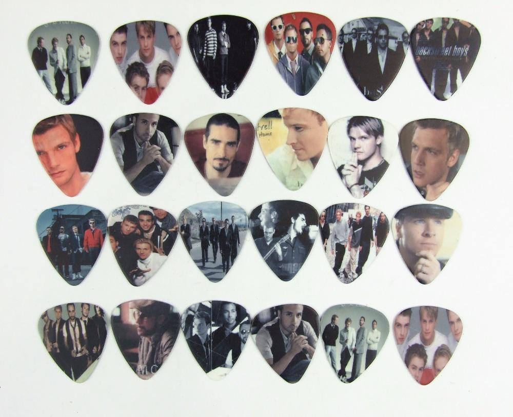 10pcs 0.71mm Backstreet Boys high quality two side earrings pick DIY design guitar accessries pick guitar picks(China (Mainland))