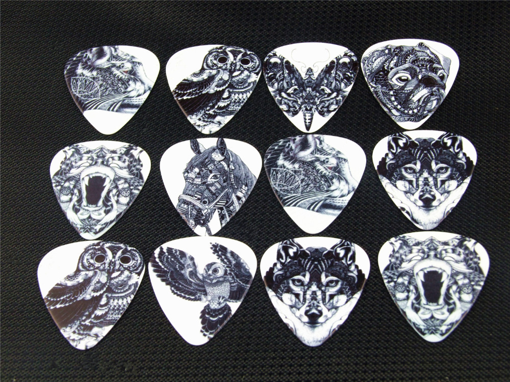 Гаджет  10PCS 1.0mm high quality guitar picks two side pick Black and white animal picks earrings DIY Mix picks guitar None Спорт и развлечения
