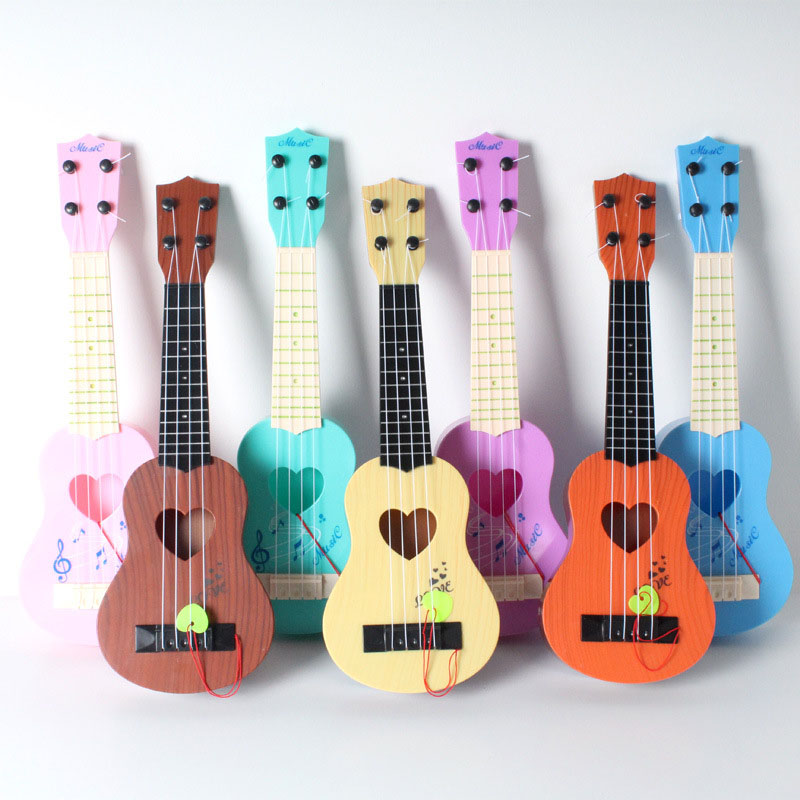 4 string children 39 s toys simulation mini heart shaped ukulele guitar play baby early childhood. Black Bedroom Furniture Sets. Home Design Ideas