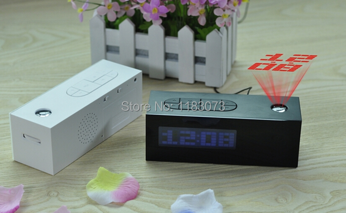 HOT!!! New Laser Projecting Alarm Clock Display Time,Date,Temperature+Projector digital desk calendar with FM radio function(China (Mainland))