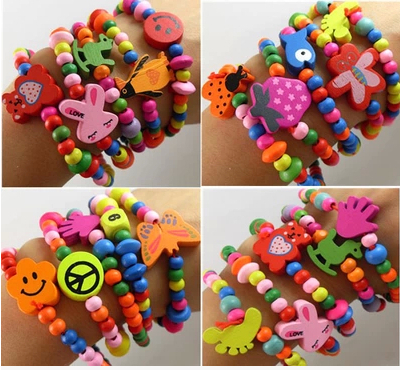 2015 fashion Free shipping 20pcs/lot Candy color child wood bracelet toy birthday gift little princess accessories(China (Mainland))