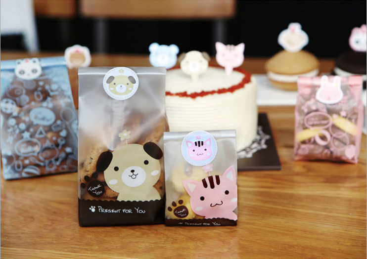 50&100pcs/lot Cute Cat and Dog Cookie Bag Bread bag Gift Candy Package Cellphone Bags Jewelry bags Send children the baking gift(China (Mainland))